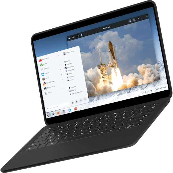 Laptop displaying a picture of a rocket