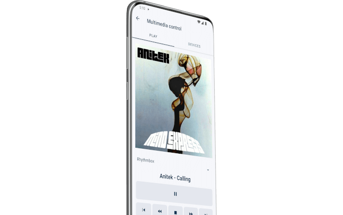 Phone displaying a song playing on the computer