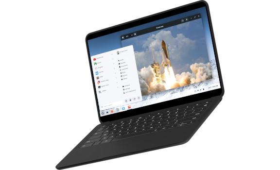 Laptop displaying a rocket